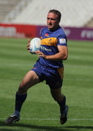 Bogdan Iosif Voicu of Romania drives the ball during the match of Rugby7 European Championship between France and Romania at the Olympic Stadium in Barcelona, on July 9, 2011