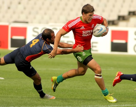 Carl Murray of Portugal drives the ball during the match of Rugby7 European Champìonship between Spain and Portugal at the Olympic Stadium in Barcelona, on July 9, 2011