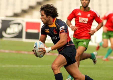 cano: Juan Cano of Spain drives the ball during the match of Rugby7 European Champìonship between Spain and Portugal at the Olympic Stadium in Barcelona, on July 9, 2011 Editorial
