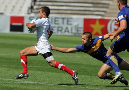 Romain Raine of France drives the ball during the match of Rugby7 European Championship between France and Romania at the Olympic Stadium in Barcelona, on July 9, 2011