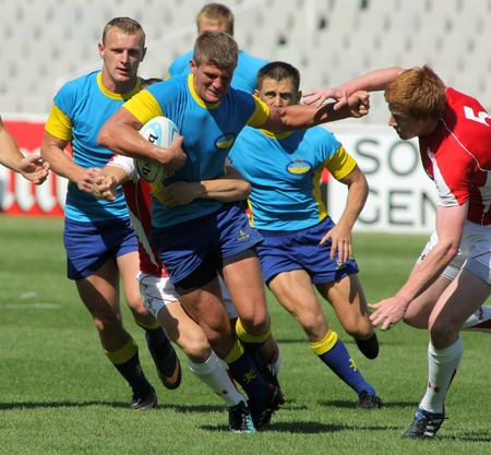 Sergei Monastyrov of Ukraine drives the ball during the match of Rugby7 European Championship between Ukraine  and Wales at the sports competition Stadium in Barcelona, on July 9, 2011 Editorial