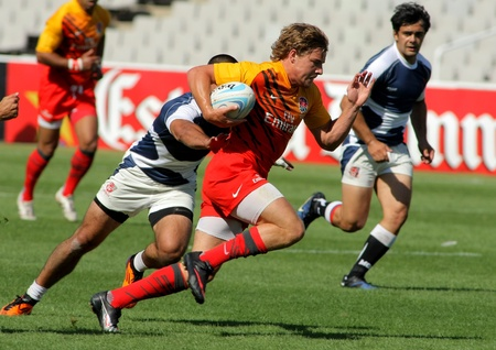 Tom Mitchell of England drives the ball during the match of Rugby7 European Championship between England and Georgia at the Olympic Stadium in Barcelona, on July 9, 2011