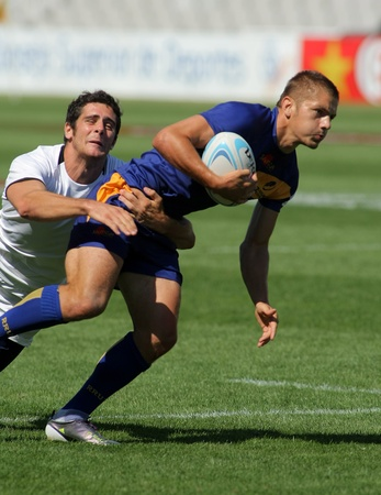 Valentin Ivan of Romania is tackled by French player during the match of Rugby7 European Championship between France and Romania at the Olympic Stadium in Barcelona, on July 9, 2011