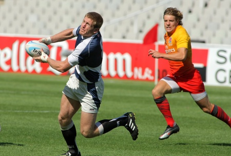 Giorgi Jimsheladze of Georgia drives the ball during the match of Rugby7 European Championship between England and Georgia at the Olympic Stadium in Barcelona, on July 9, 2011 Stock Photo - 10273914