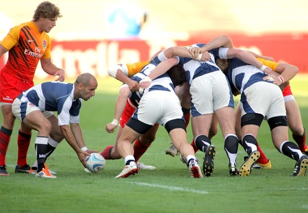 Irakli Gvinjilia of Georgia throws the ball to the scrum during the match of Rugby7 European Championship between England and Georgia  at the Olympic Stadium in Barcelona, on July 9, 2011