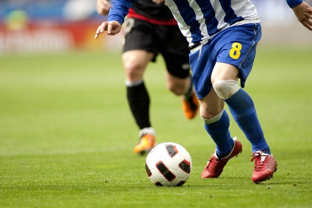 soccer game: Soccer player legs in action