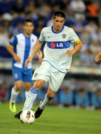 Roman Riquelme of Boca Juniors in action during a friendly match against RCD Espanyol at the Estadi Cornella on July 28, 2011 in Barcelona, Spain