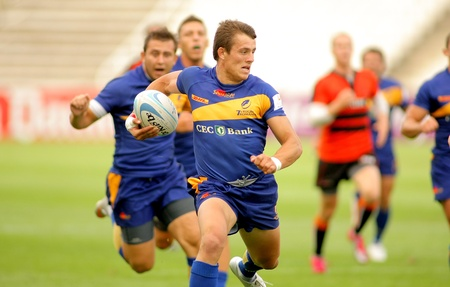 european championship: Adrian Apostol of Romania in action during the match of Rugby7 European Championship between Romania and Netherlands at the Olympic Stadium in Barcelona, on July 9, 2011