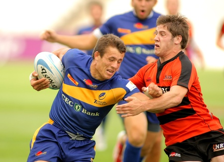 european championship: Adrian Apostol(L) of Romania fights with Rik Roovers(R) of Netherlands during the match of Rugby7 European Championship between Romania and Netherlands at the Olympic Stadium in Barcelona, on July 9, 2011