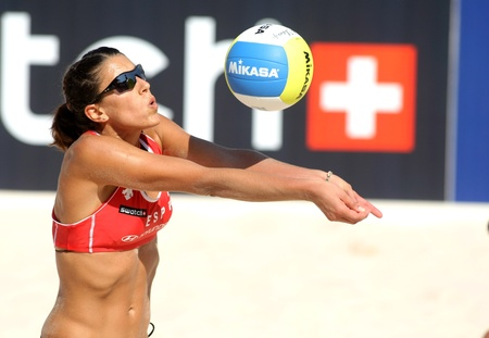 serves: Spanish beach Volley player Ester Ribera serves during a match of the Swatch FIVB Beach Volley World Tour
