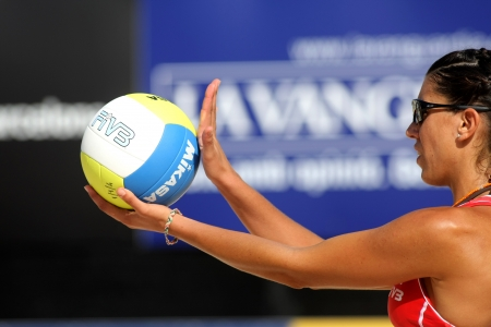 volley: Spanish beach Volley player Ester Ribera serves during a match of the Swatch FIVB Beach Volley World Tour