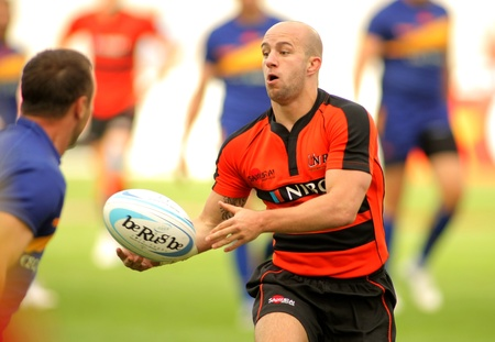9 ball: Jayjay Boske of Netherlands passes the ball during the match of Rugby7 European Championship between Romania and Netherlands  at the Olympic Stadium in Barcelona, on July 9, 2011 Editorial