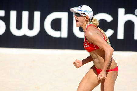 jennifer: North American beach Volley player Jennifer Kessy celebrates a point during a match of the Swatch FIVB Beach Volley World Tour
