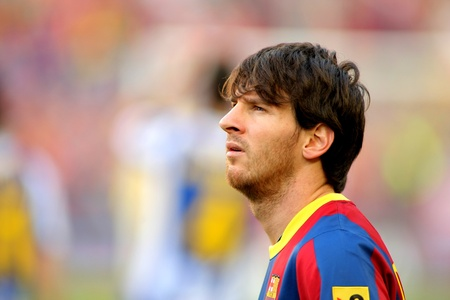 Leo Messi of FC Barcelona watch to the scoreboard during the match between FC Barcelona and RCD Espanyol at the Nou Camp Stadium on May 8, 2011 in Barcelona, Spain