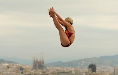 champion of spain: Diving athlete in action during a competition  of Barcelona diving trophy at Monjuich swimming pool July 24, 2011 in Barcelona, Spain