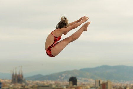 Diving athlete in action during a competition  of Barcelona diving trophy at Monjuich swimming pool July 24, 2011 in Barcelona, Spain