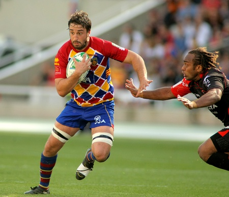 toulon: Perpignan flanker Guiry vies with Toulons Gabiriele during the Heineken European Cup quarter-final match USAP Perpignan against RC Toulon at the Olympic Stadium in Barcelona, on April 9, 2011