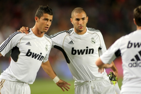 Karim Benzema(R) and Cristiano Ronaldo(L) of Real Madrid stretching before the Spanish Supercup football match against FC Barcelona at the New Camp Stadium in Barcelona, on August 17, 2011 Stock Photo - 10591723