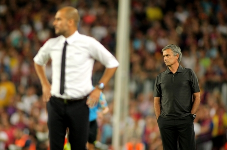 Guardiola of Barcelona and Mourinho of Madrid during the Spanish Supercup football match between Barcelona vs Real Madrid at the New Camp Stadium in Barcelona, on August 17, 2011