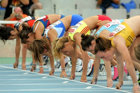 Athletes ready on the start of 100m Event of Barcelona Athletics meeting at the Olympic Stadium on July 22, 2011 in Barcelona, Spain Editorial