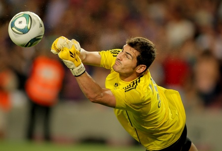 Iker Casillas of Real Madrid throws the ball  during the Spanish Supercup football match between Barcelona vs Real Madrid at the New Camp Stadium in Barcelona, on August 17, 2011
