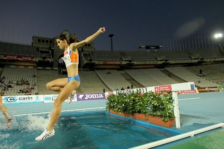 steeplechase: Estefania Tobal of Spain in action on 3000m steeplechase Event of Barcelona Athletics meeting at the Olympic Stadium on July 22, 2011 in Barcelona, Spain