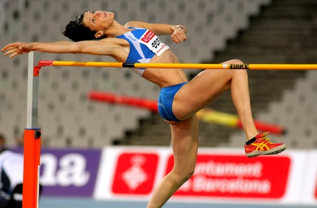 high jump: Ruth Beitia of Spain jumping on Hight jump Event of Barcelona Athletics meeting at the Olympic Stadium on July 22, 2011 in Barcelona, Spain