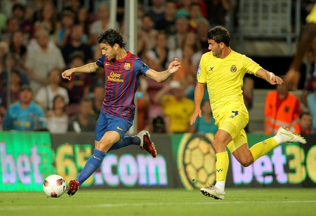 Cesc Fabregas of FC Barcelona in action during a Spanish League match between FC Barcelona and Villarreal at the Nou Camp Stadium on August 29, 2011 in Barcelona, Spain Stock Photo - 10753045