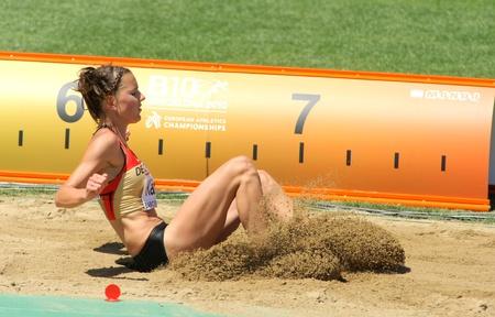 salto largo: Nadja Kather de Alemania compite en el salto largo mujer durante el 20 Campeonato Europeo de Atletismo en el Estadio Olímpico el 27 de julio de 2010 en Barcelona, ??España Editorial