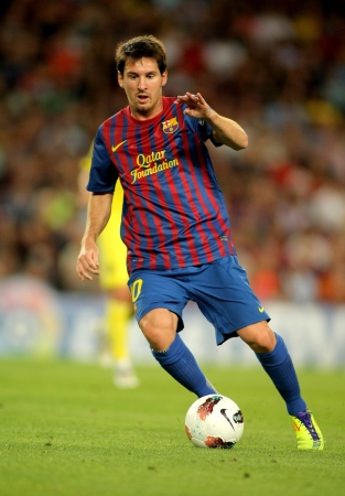 Leo Messi of FC Barcelona in action during a Spanish League match between FC Barcelona and Villarreal at the Nou Camp Stadium on August 29, 2011 in Barcelona, Spain