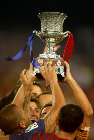 FC Barcelona players hold up Supercup trophy after the Spanish Supercup football match at the New Camp Stadium in Barcelona, on August 17, 2011
