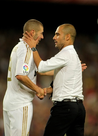 pep: Karim Benzema of R Madrid and FC Barcelona coach Guardiola shake hands after the Spanish Supercup football match between FC Barcelona and R Madrid at the New Camp Stadium in Barcelona, on August 17, 2011 Editorial
