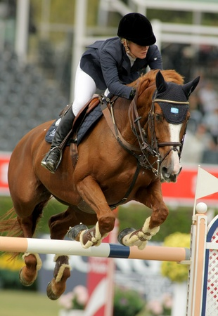 girth: Angelica Augustsson in action rides horse Mic Mac Du Tillard during the 100th CSIO event at the Real Club de Polo Barcelona on September 23, 2011 in Barcelona, Spain