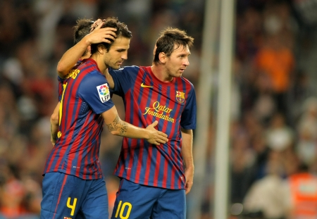 Cesc Fabregas and Leo Messi of FC Barcelona celebrate goal during the spanish league match against Osasuna at the Nou Camp Stadium on September 17, 2011 in Barcelona, Spain