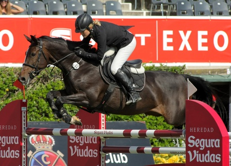 girth: Laura Renwick in action rides horse Beluga Li during the 100th CSIO event at the Real Club de Polo Barcelona on September 23, 2011 in Barcelona, Spain