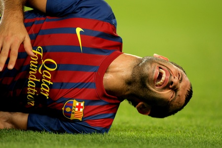 Javier Mascherano of FC Barcelona injured during the spanish league match against Osasuna at the Nou Camp Stadium on September 17, 2011 in Barcelona, Spain