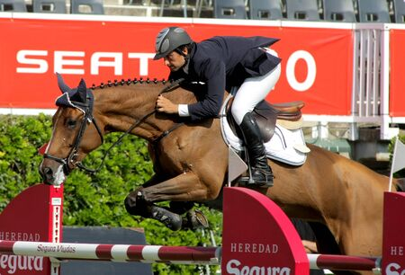 girth: Mateu Vivas in action rides horse Wienta Parflan during the 100th CSIO event at the Real Club de Polo Barcelona on September 23, 2011 in Barcelona, Spain