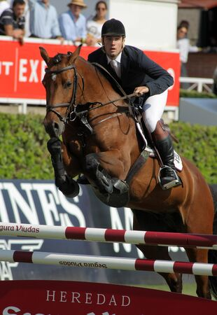 girth: Eugenio Corell in action rides horse Apolo 817 during the 100th CSIO event at the Real Club de Polo Barcelona on September 23, 2011 in Barcelona, Spain