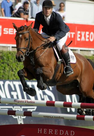Eugenio Corell in action rides horse Apolo 817 during the 100th CSIO event at the Real Club de Polo Barcelona on September 23, 2011 in Barcelona, Spain Stock Photo - 11013462