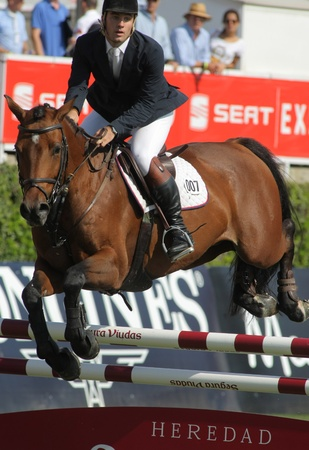 Eugenio Corell in action rides horse Apolo 817 during the 100th CSIO event at the Real Club de Polo Barcelona on September 23, 2011 in Barcelona, Spain
