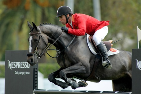 Jesus Garmendia of Spain in action rides horse Perle Condeenne during the 100th CSIO event at the Real Club de Polo Barcelona on September 23, 2011 in Barcelona, Spain