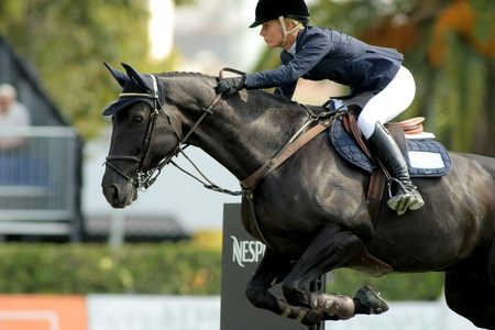 BARCELONA, SPAIN - SEPT, 23: Angelica Augustsson in action rides horse Walter 61 during the 100th CSIO event at the Real Club de Polo Barcelona on September 23, 2011 in Barcelona, Spain