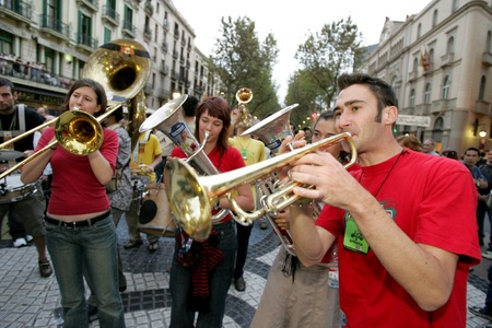 the ramblas: Musicians of music troop Les Ouiche Lorenea in full swing performing his show at Las Ramblas during a Festival City on September 24, 2004 in Barcelona, Spain