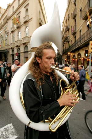 yuri: Trombonist of music troop Yuri i la seva banda de cosmonautes in full swing performing his show at Las Ramblas during a Festival City on September 24, 2004 in Barcelona, Spain
