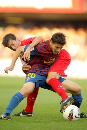 Marti Riverola of FC Barcelona vies with Lanzarote of CE sabadell during the spanish second division match at the Mini Estadi on October 1, 2011 in Barcelona, Spain Stock Photo - 11063567