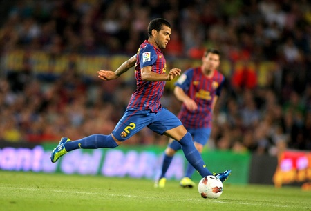 Daniel Alves of FC Barcelona in action during the spanish league match against Atletico Madrid at the Nou Camp Stadium on September 24, 2011 in Barcelona, Spain