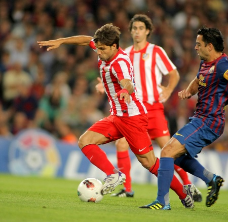 winger: Diego Ribas da Cunha of Atletico Madrid in action during the spanish league match against Fc Barcelona at the Nou Camp Stadium on September 24, 2011 in Barcelona, Spain