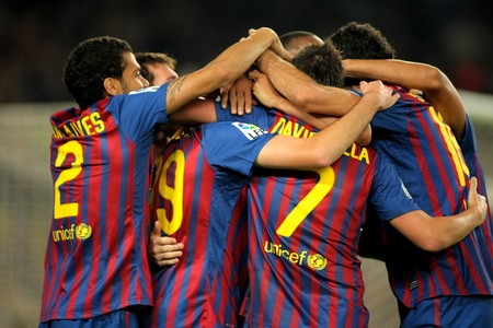 Group of FC Barcelona players celebrating goal during the spanish league match between FC Barcelona and RCD Mallorca at the Nou Camp Stadium on October 29, 2011 in Barcelona, Spain Stock Photo - 11366197