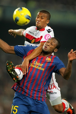 winger: Gianni Zuiverloon(L) of Mallorca vies with Seydou Keita(R) of Barcelona in action during the spanish league match at the Nou Camp Stadium on October 29, 2011 in Barcelona, Spain