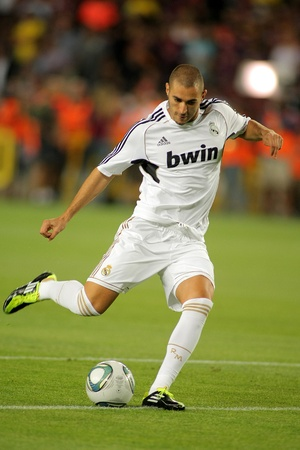winger: Karim Benzema of Real Madrid in action during the Spanish Supercup football match against FC Barcelona at the New Camp Stadium on August 17, 2011 in Barcelona, Spain Editorial